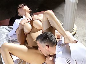 Boobtastic Yurizan Beltran stretches her legs on the massage table