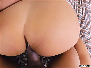 steamy backside dark haired Abella Danger riding wood in her booty