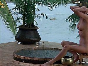 stunning Bo Derek displaying off her hairy snatch at the beach