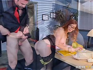 Dani Jensen toying with wood in the office
