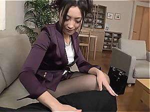japanese condom dealer tests her groin with a customer