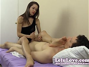 She wanks his bone while kneading her soles and feet